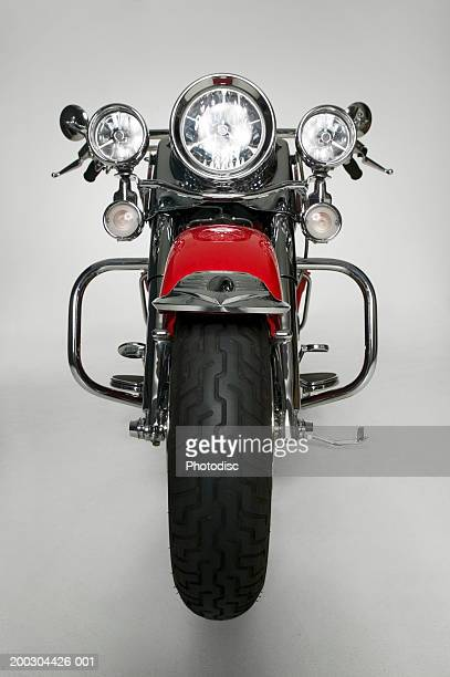 Large red motorbike in studio, (Front view)