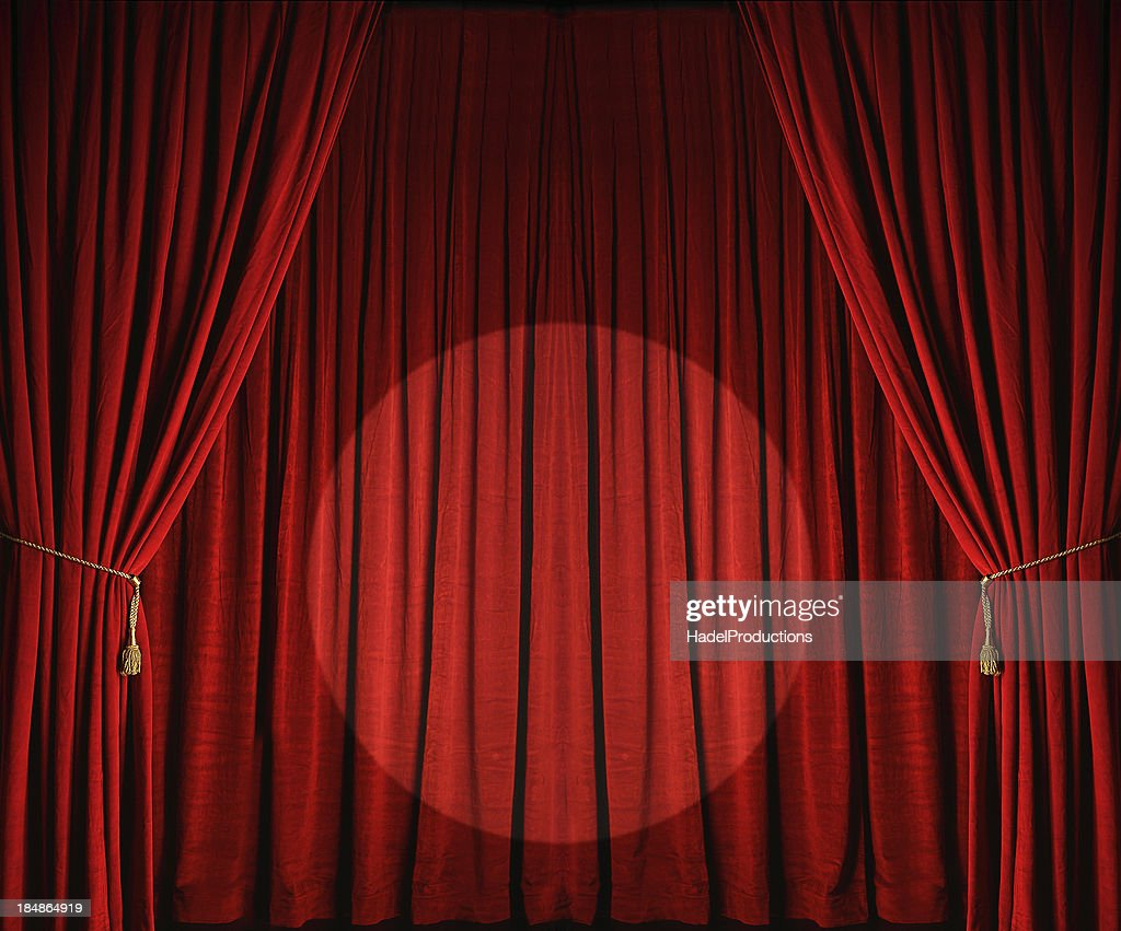 Stage curtains spotlight - Large Red Theatre Curtains With Spotlight Stock Photo
