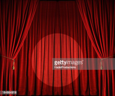 Large red theatre curtains with spotlight
