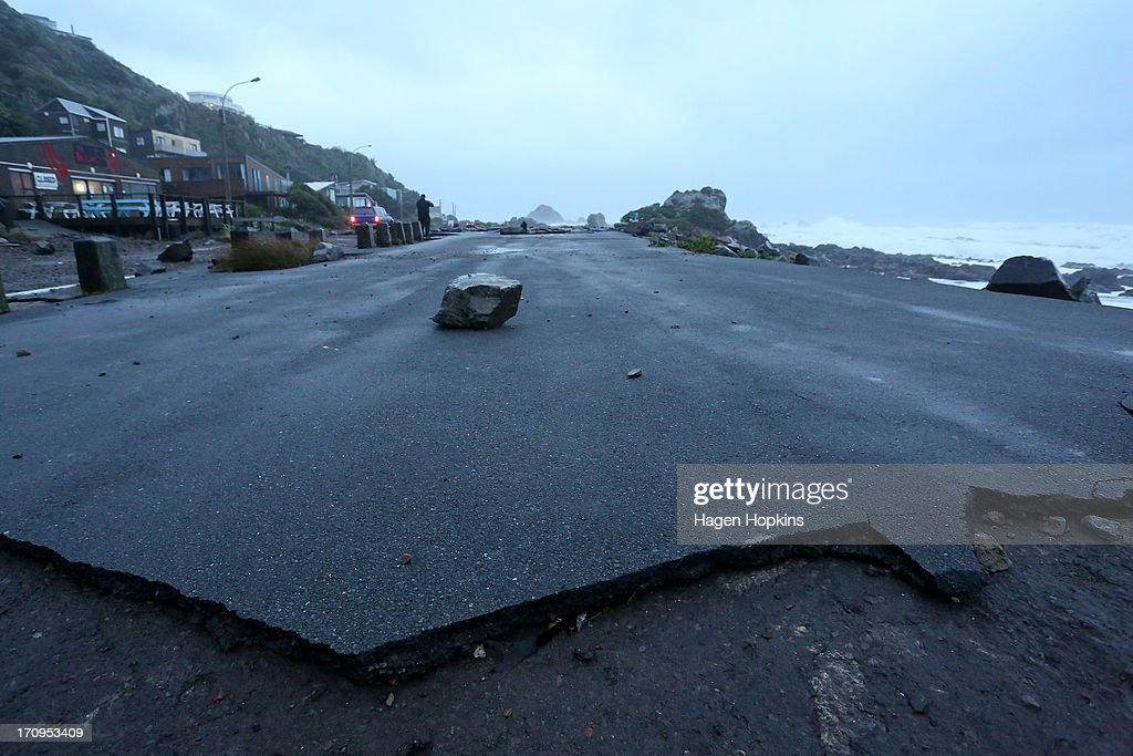 A large rock lies in the middle of a damaged carpark on The Esplanade in Owhiro Bay after a storm on June 21, 2013 in Wellington, New Zealand. Winds reached up to 200km per hour during the storm and around 30,000 homes were left without power across the Wellington region.