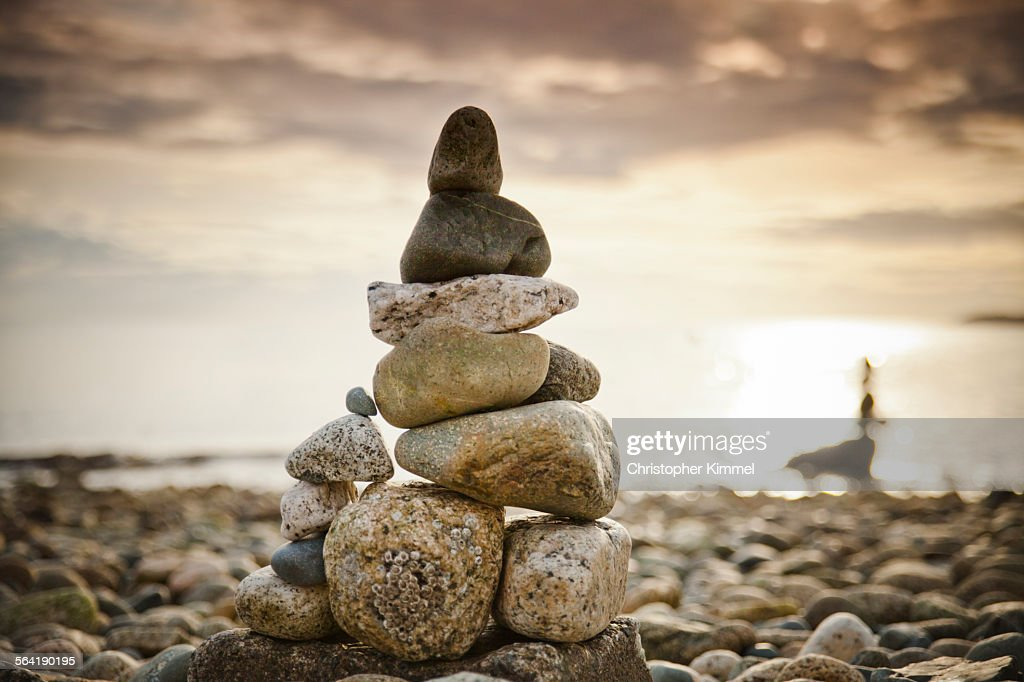 A large rock stack is built on a beach near Sechelt, BC, Canada.