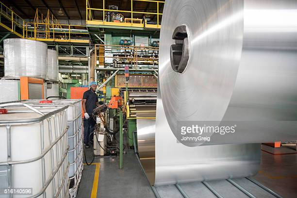 Large roll of aluminium in processing plant