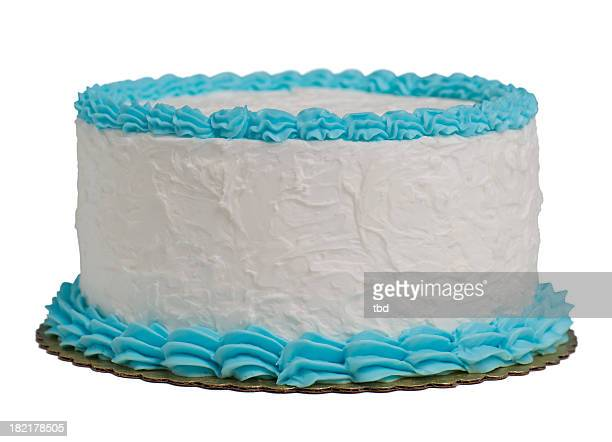 A large round cake with blue and white frosting isolated