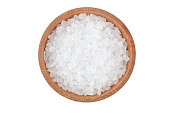 large salt in a wooden saltcellar isolated on a white background