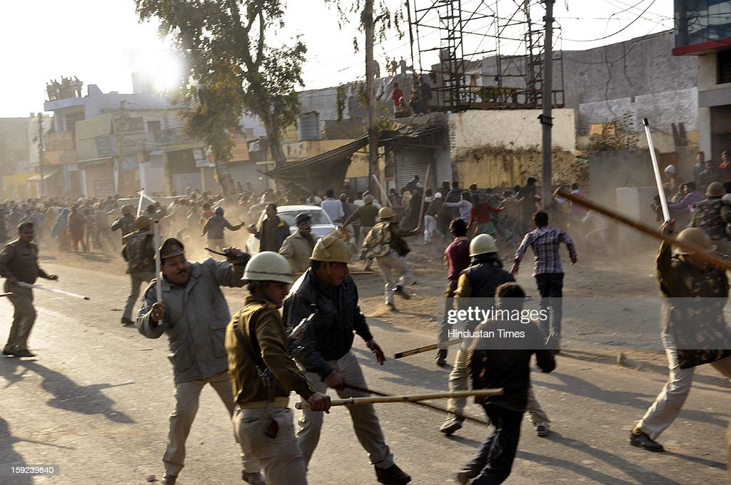 Large scale rioting started at NH-58 near Sihani after the dead body of a five year old minor girl was found at nearby Subhash Nagar locality this noon, on January 10, 2013 in Ghaziabad, India. Police had to resort to lathicharge and tear-gas use when the protestors denied handing over the dead body to police for post-mortem purpose.