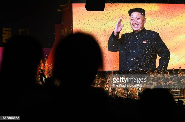 A large screen photo of ruler Kim Jong Un and sparkling confetti cap an evening concert at the Pyongyang Arena in Pyongyang North Korea on May 11...