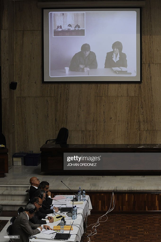 A large screen shows as former military Hugo Leonardo ( L) testifies by means of a video-conference in the trial against former Guatemalan dictator (1982-1983),General (retired) Jose Efrain Rios Montt (out of frame), in Guatemala City on April 4, 2013. Rios Montt, who stands trial despite defense attempts to postpone the start of the historic proceedings, is accused of ordering the execution of 1,771 members of the indigenous Ixil Maya people in the Quiche region. Rios Montt refrained from testifying. AFP PHOTO/Johan ORDONEZ