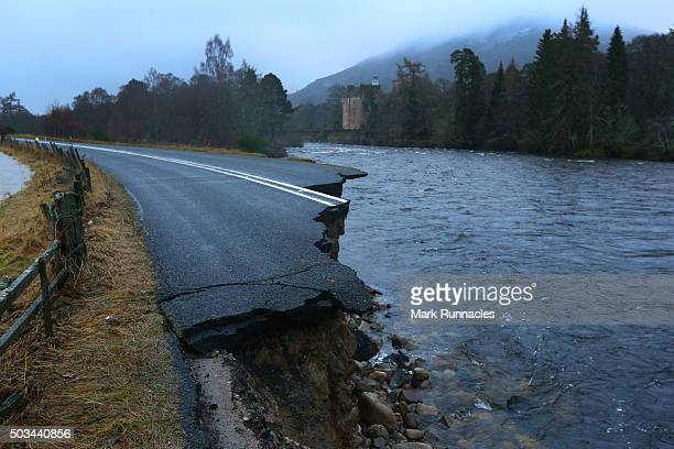 A large section of the A93 road between Ballater and Baemar swept away by storm surge on the River Dee on January 5 2016 in Ballater United Kingdom...