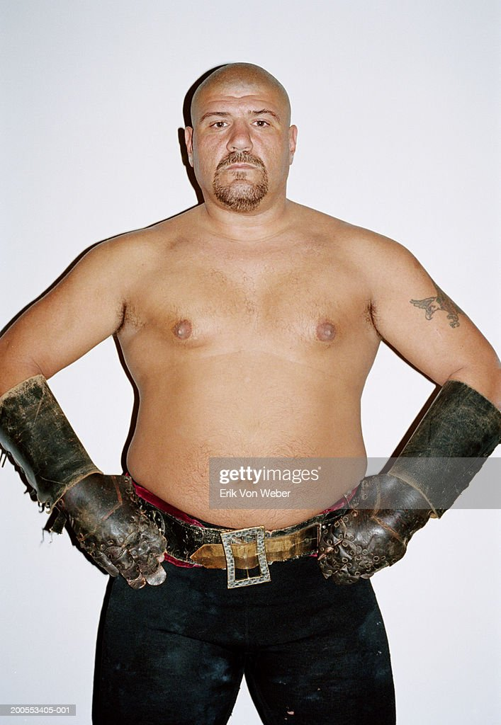 Large shirtless man wearing leather gloves, portrait : Stock Photo
