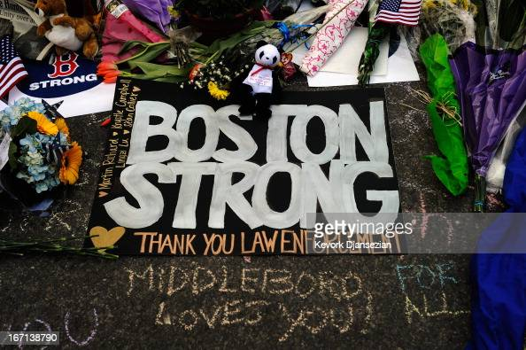 A large sign with the names of the Boston Marathon bombing victims and thanking law enforcement is placed by a Boston Bruins hockey team fan at a...