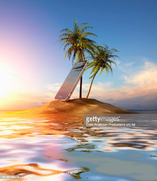 Large smart phone beached on tropical island