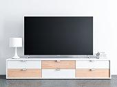 Large Smart TV set on great console, concrete floor, 3d rendering