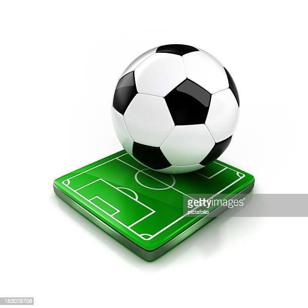 Large soccer ball sitting on small soccer field