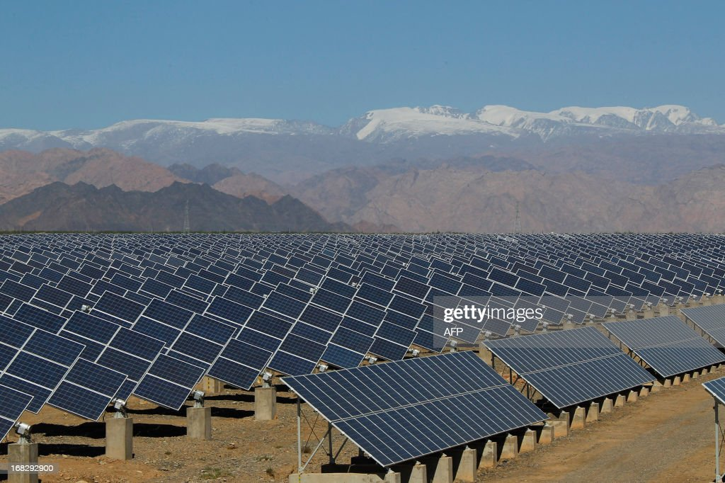 Large solar panels are seen in a solar power plant in Hami, northwest China's Xinjiang Uygur Autonomous Region on May 8, 2013. The EU executive on May 8 proposed heavy anti-dumping tariffs of around 47 percent on imports of Chinese solar panels, a European Union source said. CHINA