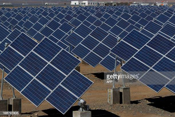 Large solar panels are seen in a solar power plant in Hami northwest China's Xinjiang Uygur Autonomous Region on May 8 2013 The EU executive on May 8...