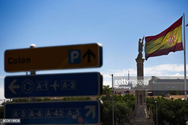 A large Spanish national flag flies on Colon Square in Madrid on Wednesday June 28 2017 Bankia SA agreed to acquire Banco Mare Nostrum SA in an...
