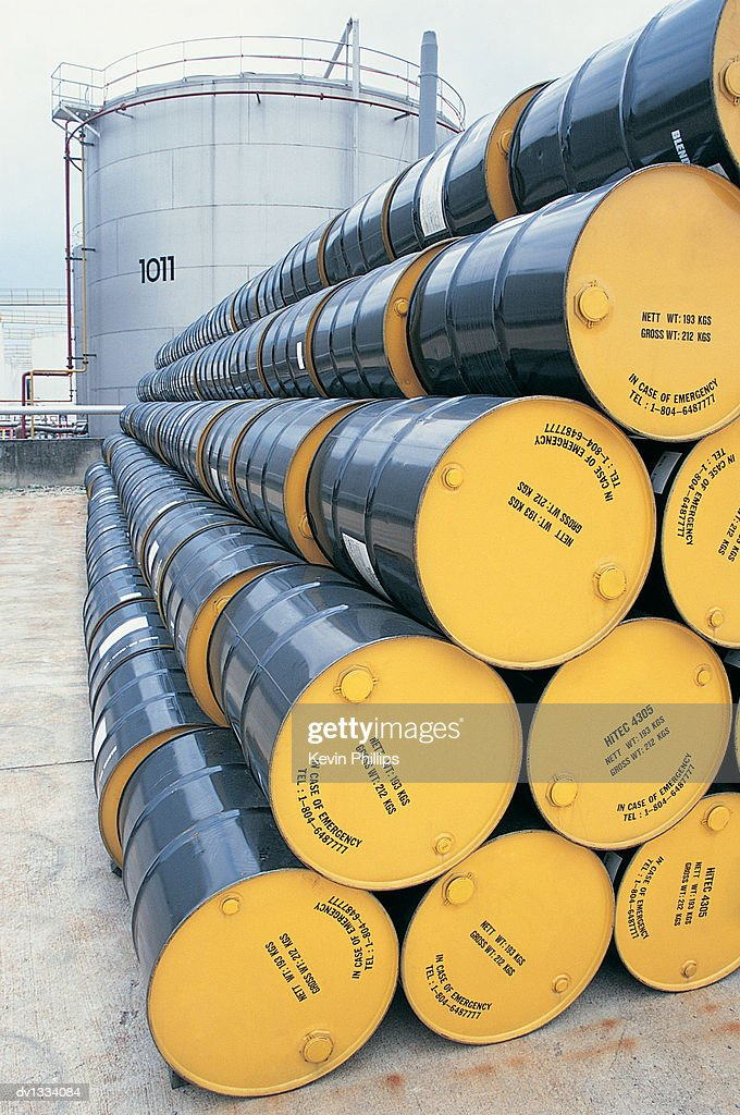 Large Stack of Oil Drums in a Line at an Oil Refinery : Stock Photo
