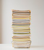 Large stack of paperwork in wire basket