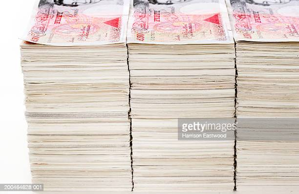 Large stacks of fifty pound banknotes, close-up