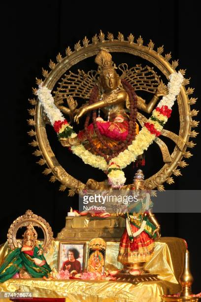 Large statue of Lord Shiva represented as the Nataraja during a Bharatnatyam Arangetram in Brampton Ontario Canada The Bharatnatyam Arangetram is the...