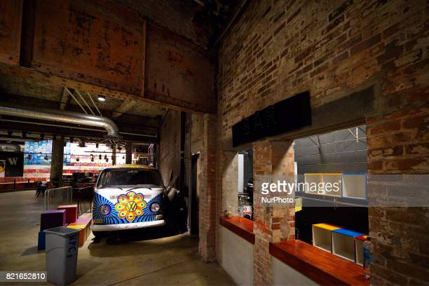 Large steel beams and exposed brick wall from the original structure are visible in the main lobby of the Fillmore Philadelphia The entertainment...