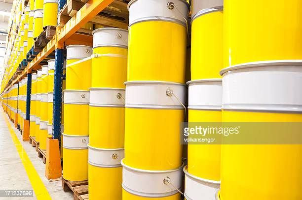 A large stock of industrial sized paint cans
