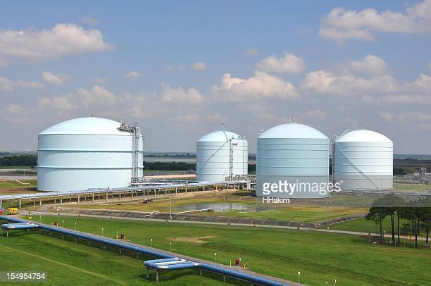 Large storage tanks in a factory field