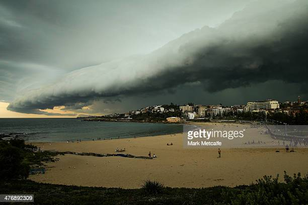 A large storm cloud covers Coogee Beach on March 5 2014 in Sydney Australia A severe thunderstorm warning was issued for the Sydney metropolitan area...