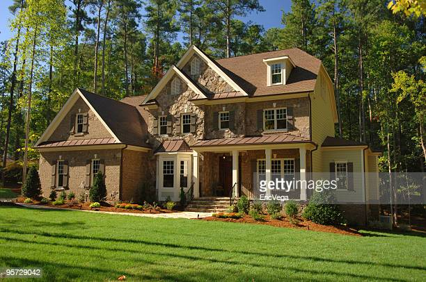 Large suburban home with forest back drop
