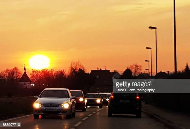 Large Sun Rises During Morning Commute