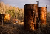 Large tanks left to rust at an abandoned oil sands mining site that has been out of commission since the 1950s are seen on April 28th north of Fort...