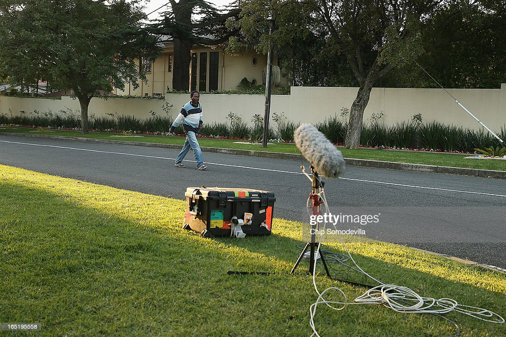 A large television microphone is pointed toward former South Africa President Nelson Mandela's home April 1, 2013 in Johannesburg, South Africa. Journalists are camped out across the street from the home while Mandela, 94, is recovering from pneumonia in hospital, his third stay in the last four months. Mandela's lungs were damaged when he contracted tuberculosis during his 27 years in the infamous Robben Island prison. Mandela became the nation's first democratically elected president in 1994 following the end of apartheid.