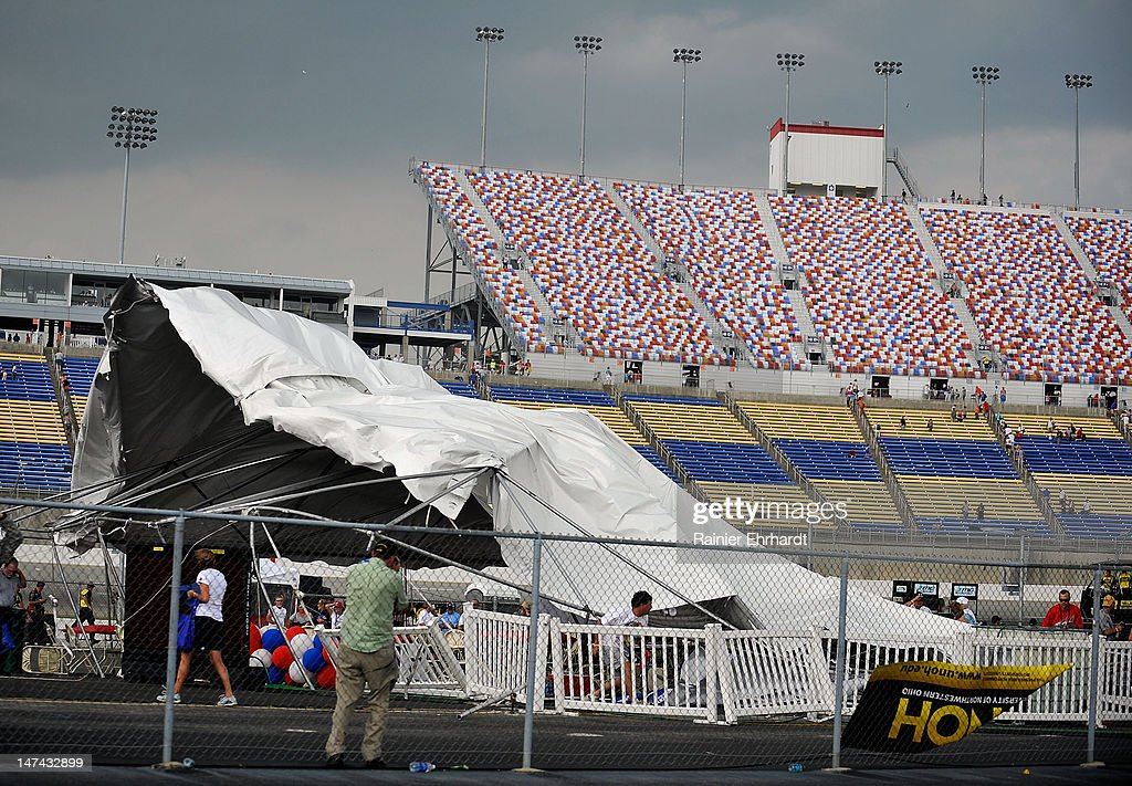 A large tent blows over as high winds hit during qualifying for the NASCAR Sprint Cup Series Quaker State 400 at Kentucky Speedway on June 29, 2012 in Sparta, Kentucky.