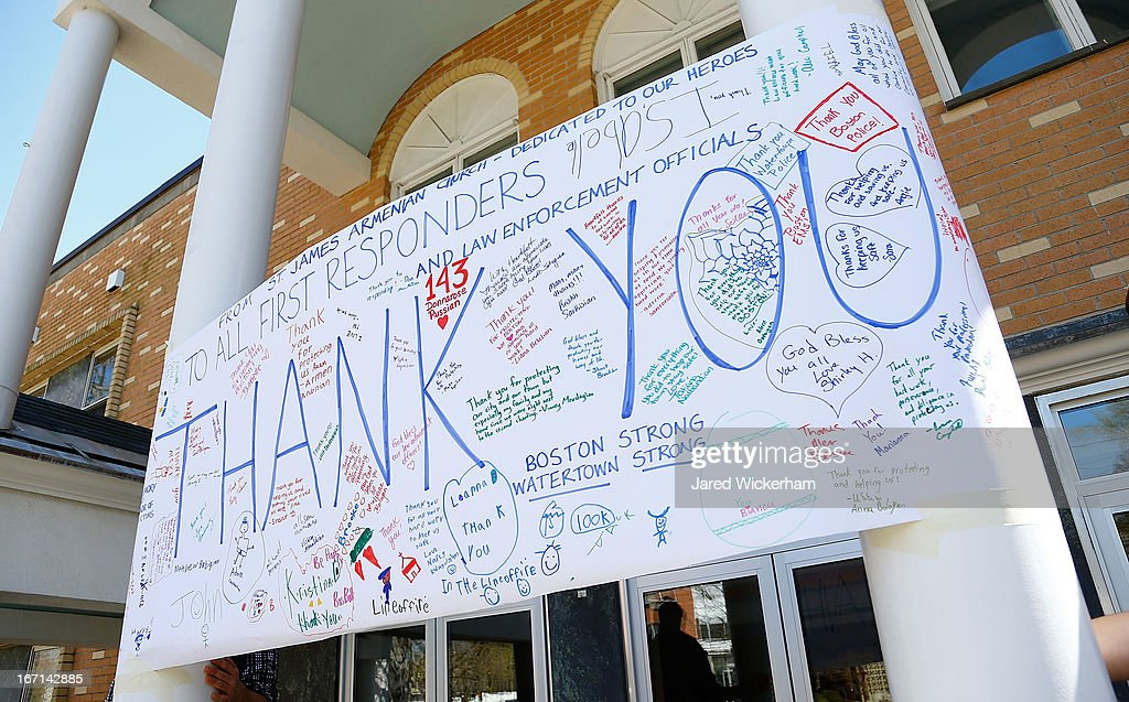 A large 'Thank You' poster, created by the St James Armenian Church youth group that includes personal messages for members of law enforcement and first responders, is displayed on Mount Auburn Street on April 21, 2013 in Watertown, Massachusetts. A manhunt for Dzhokhar A. Tsarnaev, 19, a suspect in the Boston Marathon bombing ended after he was apprehended on a boat parked on a residential property in Watertown, Massachusetts. His brother Tamerlan Tsarnaev, 26, the other suspect, was shot and killed after a car chase and shootout with police. The bombing, on April 15 at the finish line of the marathon, killed three people and wounded at least 170.