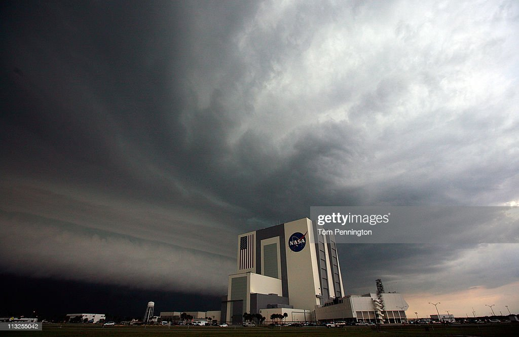 A large thunder storm moves over the Vehicle Assembly Building as the Space Shuttle Endeavour sits on Pad-39A on April 28, 2011 in Cape Canaveral, Florida. NASA continues to prepare for the last trip to orbit for Space Shuttle Endeavour, which will be launching on April 29.