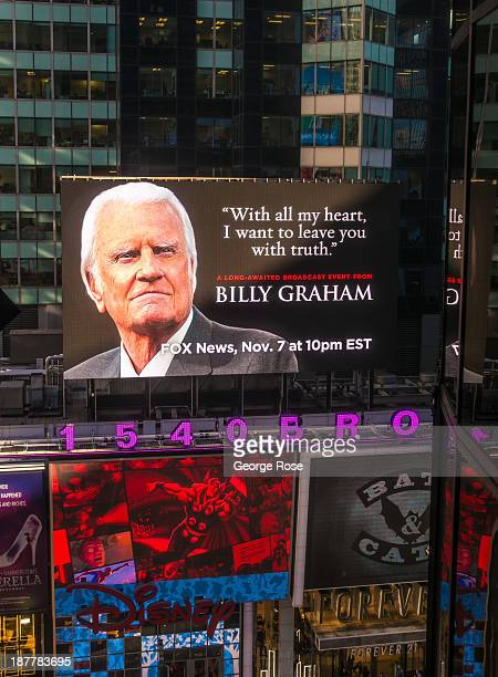 A large Times Square billboard promoting a Fox Television interiew with evangelist Billy Graham is viewed from a nearby building on October 21 2013...