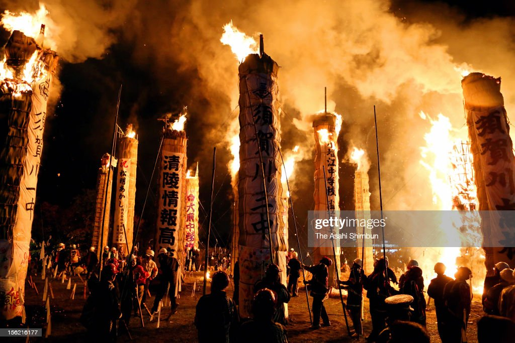 Large torches blazing at night at Japanese traditional bonfire festival Taimatsu Akashi, carried out in memoriam and hope for future restoration on November 10, 2012 in Sukagawa, Fukushima, Japan.