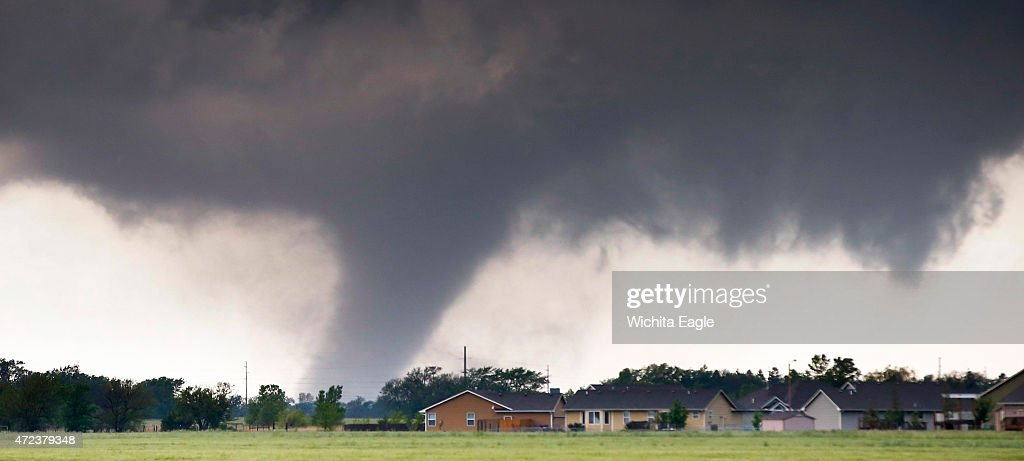 A large tornado passes just to the west of the city of Halstead Kan on Wednesday May 6 2015 Several buildings were destroyed and one person was...