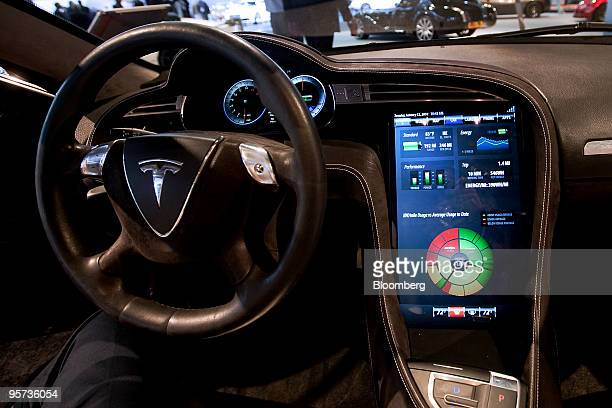 A large touchscreen in Tesla Motors Inc's Model S electric car displays battery status during day two of the 2010 North American International Auto...