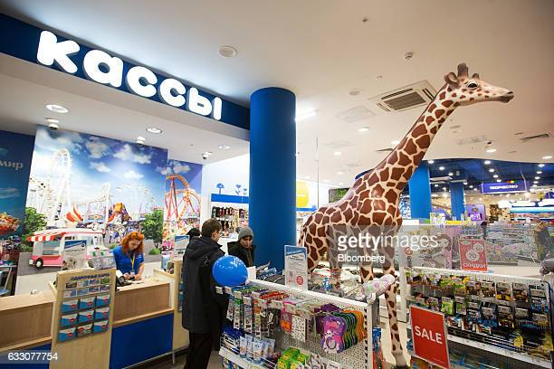 A large toy giraffe stands on display near the checkout counters inside the Detsky Mir PJSC children's goods store on Znamenka street in Moscow...