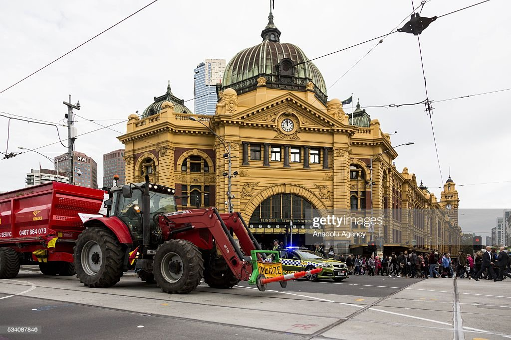 A large tractor drives past Flinders Street station during a protest demanding Australian government solve the dairy crisis in Melbourne, Australia on May 25, 2016.