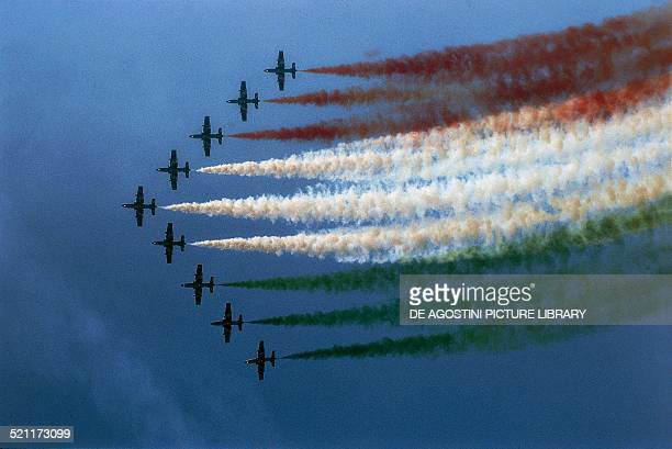 Large tricolor wing aerobatic demonstration by the Italian Air Force National Aerobatic Team using Aermacchi MB339 planes Italy late 20th century...
