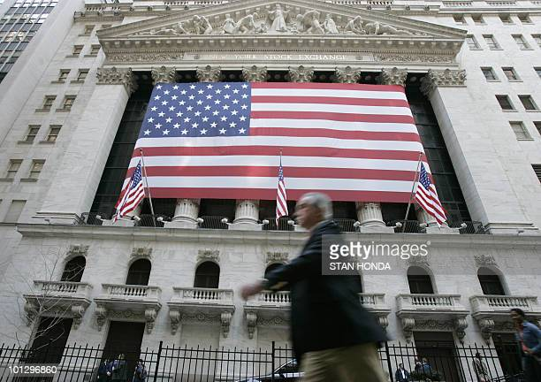 A large US flag on front of the New York Stock Exchange 23 April 2007 The Dow Jones Industrial Average opened at 12 961 a record high as it comes...
