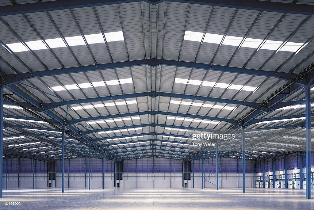 Large vacant hangar : Stock Photo