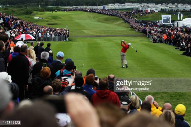 A large vocal crowd watch as Rory McIlroy of Northern Ireland hits his tee shot on the 1st hole during Day One of the 2012 Irish Open held on the...
