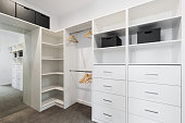 Large walk in wardrobe cabinetry detail in new home