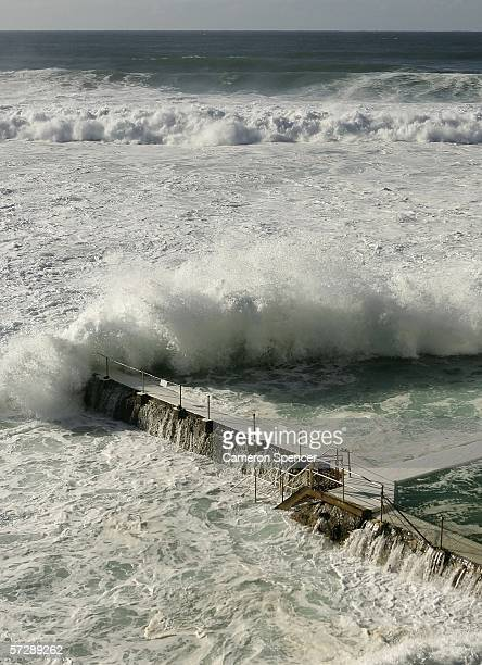 A large wave crashes across the Icebergs pool at Bondi Beach April 9 2006 in Sydney Australia A deep lowpressure system in the Southern Tasman Sea...