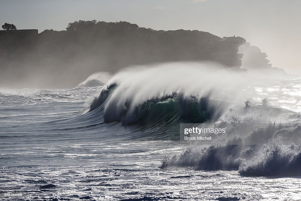 Large waves break across Bronte Beach at first light on May 25, 2016 in Sydney, Australia. All Sydney beaches were closed to swimmers today as large waves pounded the coast.