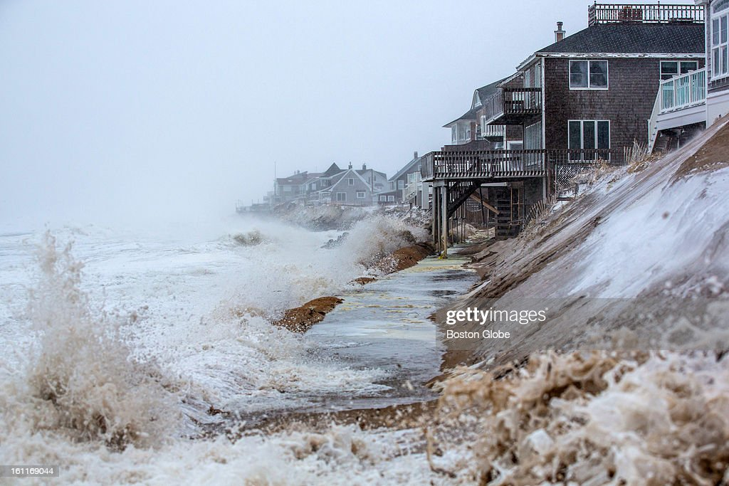 Large waves crashed over the sand barriers along the beach on Plum Island as a large winter storm hit the region.