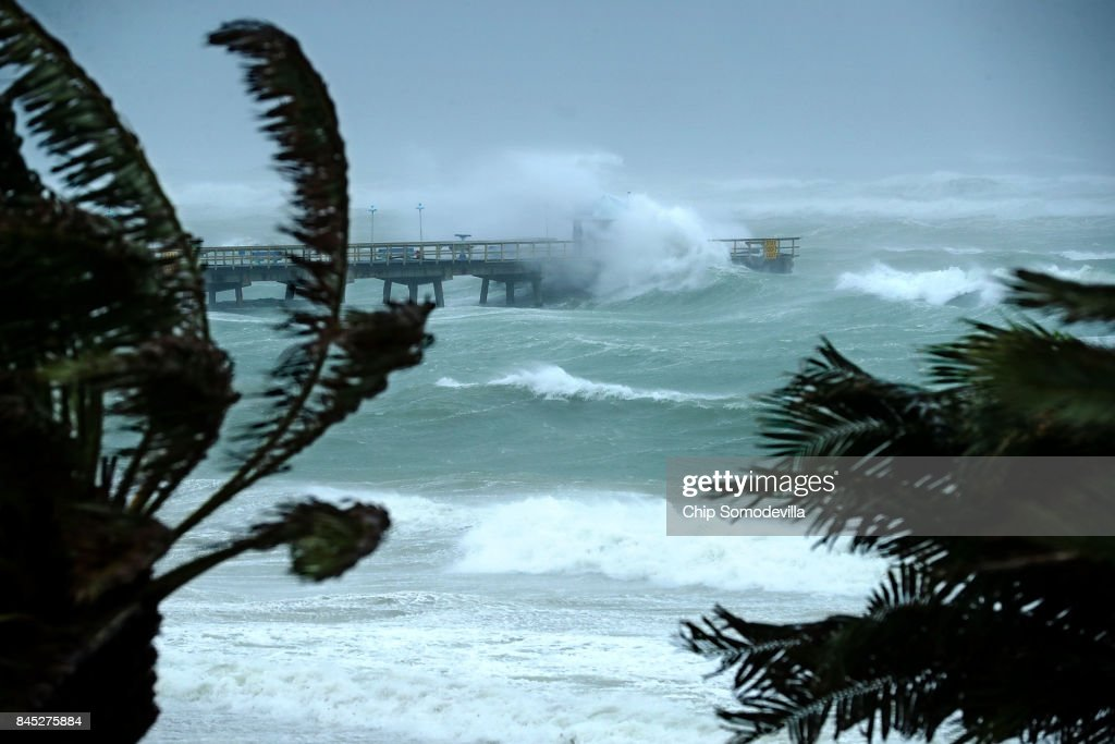 Large waves produced by Hurricane Irma crash into the end of Anglins Fishing Pier September 10, 2017 in Fort Lauderdale, Florida. The category 4 hurricane made landfall in the United States in the Florida Keys at 9:10 a.m. after raking across the north coast of Cuba.